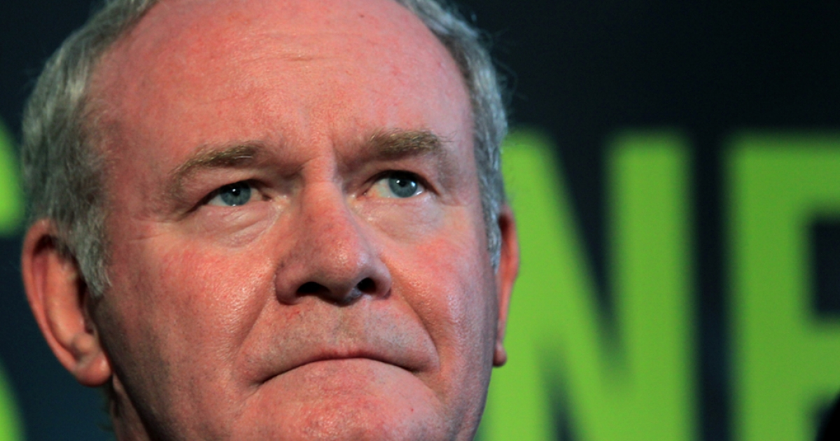 Sinn Fein's Martin McGuinness stands with party colleagues as he prepares to speak to the media during a press conference, after being officially chosen by his party to be the candidate for the upcoming Irish Presidential election, at the Writers' Centre in Dublin, on September 18, 2011.</p>