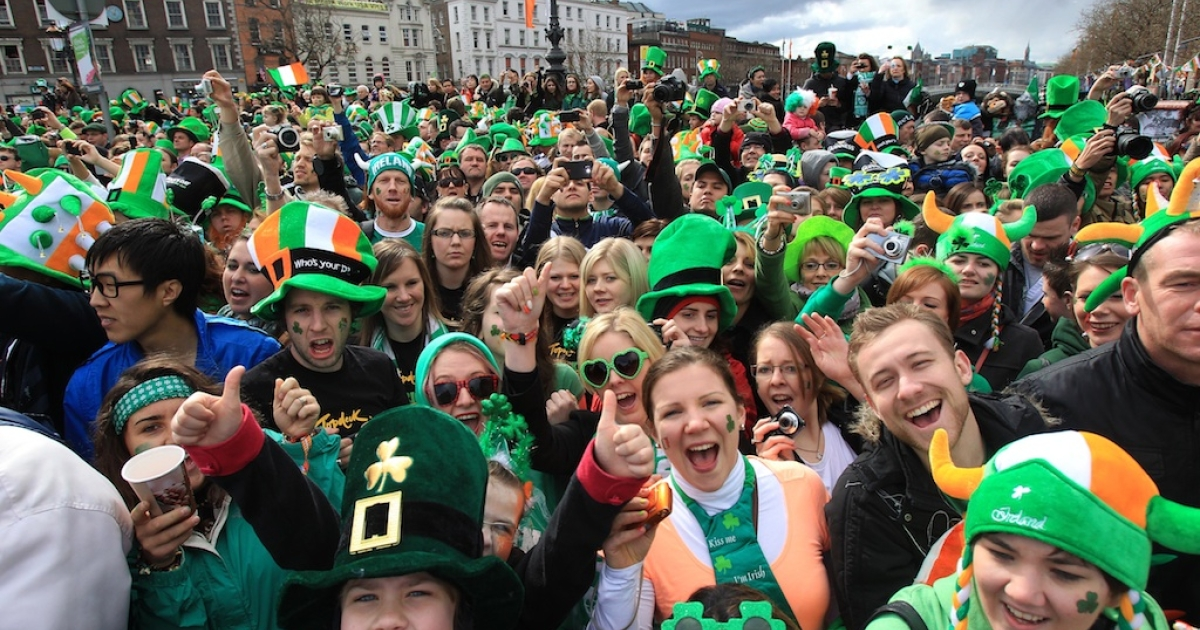 Parade goers shout as they watch St Patrick's Day festivities in Dublin, Ireland on March 17, 2012. More than 100 parades are being held across Ireland to mark St Patrick's Day, with up to 650,000 spectators expected to attend the parade in Dublin.</p>