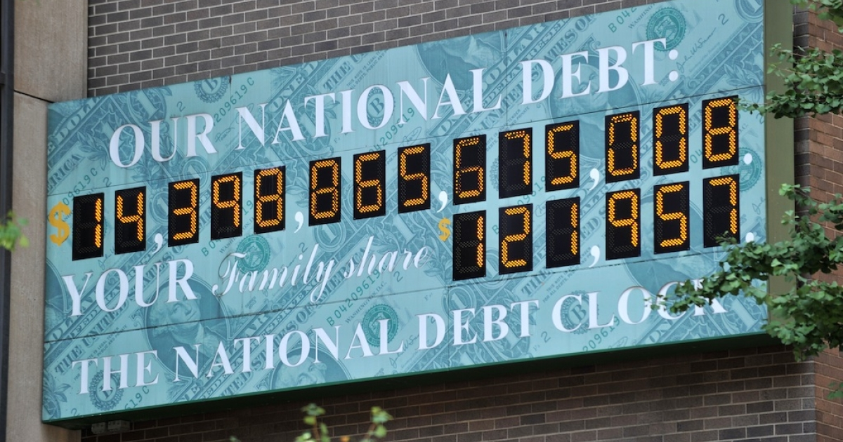 The National Debt Clock, a billboard-size digital display showing the increasing US debt, near an office of the Internal Revenue Service (IRS) on Sixth Avenue July 26, 2011 in New York.</p>
