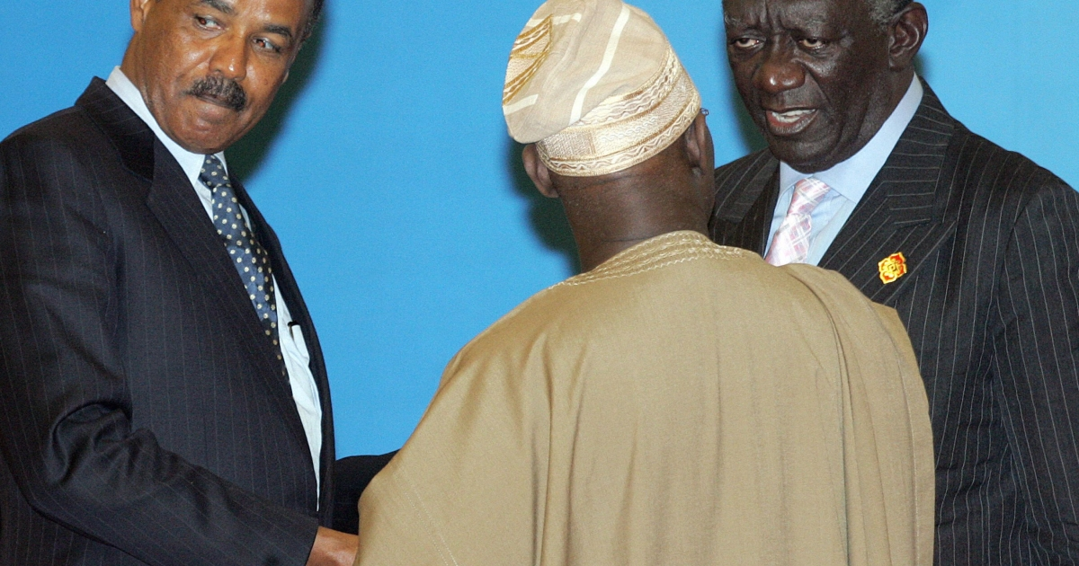 President of Eritrea Isaias Afewerki (L) chats with Nigerian President Olusegun Obasanjo (C) and Ghanaian President John Agyekum Kufuor (R) following a two-day China-Africa summit in Beijing in November 2006.</p>
