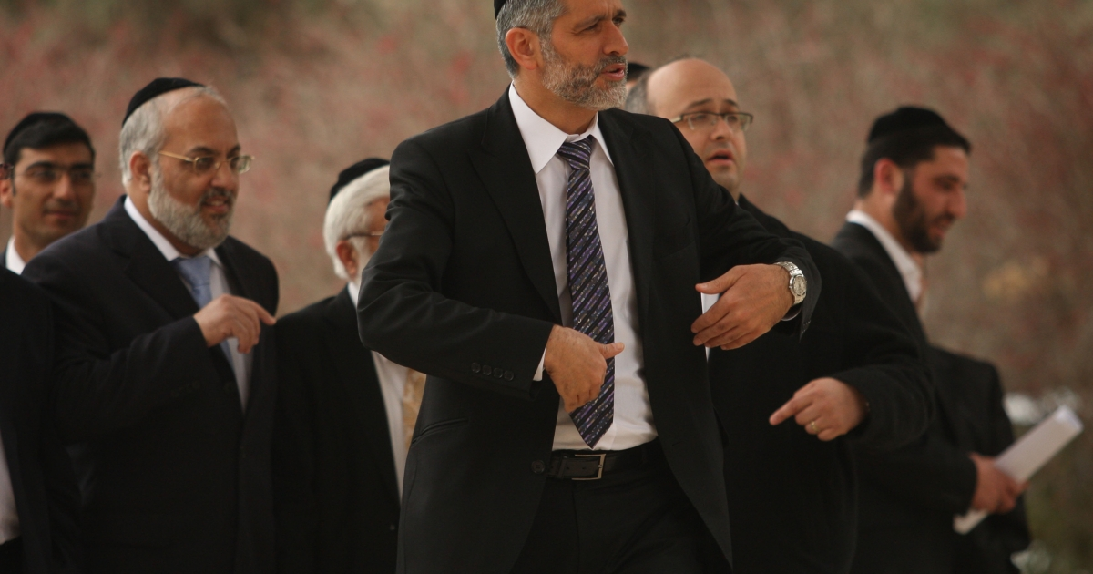 Eli Yishai, (C) head of the ultra-Orthodox Shas party, arrives for a meeting with President Shimon Peres to advise the veteran Israeli politician on his choice to head a new coalition government February 19, 2009 in Jerusalem.</p>