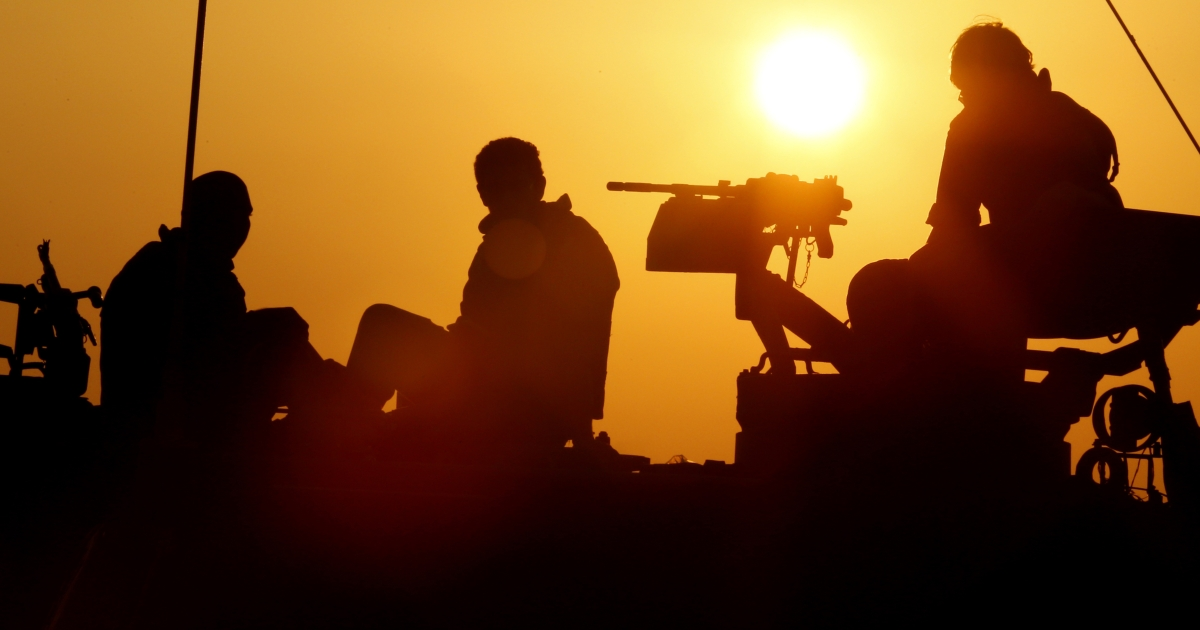 Israeli soldiers sit on top of an Israeli mobile artillery canon unit at an army deployment area near the Israel-Gaza Strip border on Nov. 20, 2012. A ceasefire to end almost a week of violence in and around the Gaza Strip is to be announced in Cairo, Hamas and Islamic Jihad sources told AFP.</p>