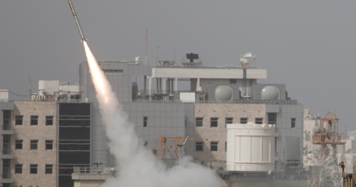 An Israeli missile is launched from the Iron Dome missile system in response to a rocket launch from the Gaza Strip.</p>