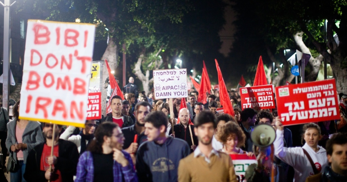 People demonstrate against a possible Israeli military attack and war with Iran on March 24, 2012 in Tel Aviv, Israel.</p>