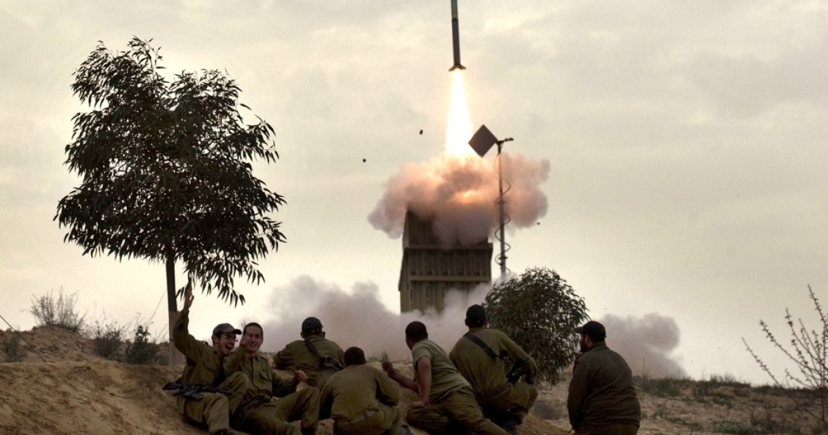 Israeli soldiers watch as a missile is launched from the southern Israeli city of Beer Sheva on March 12, 2012.</p>