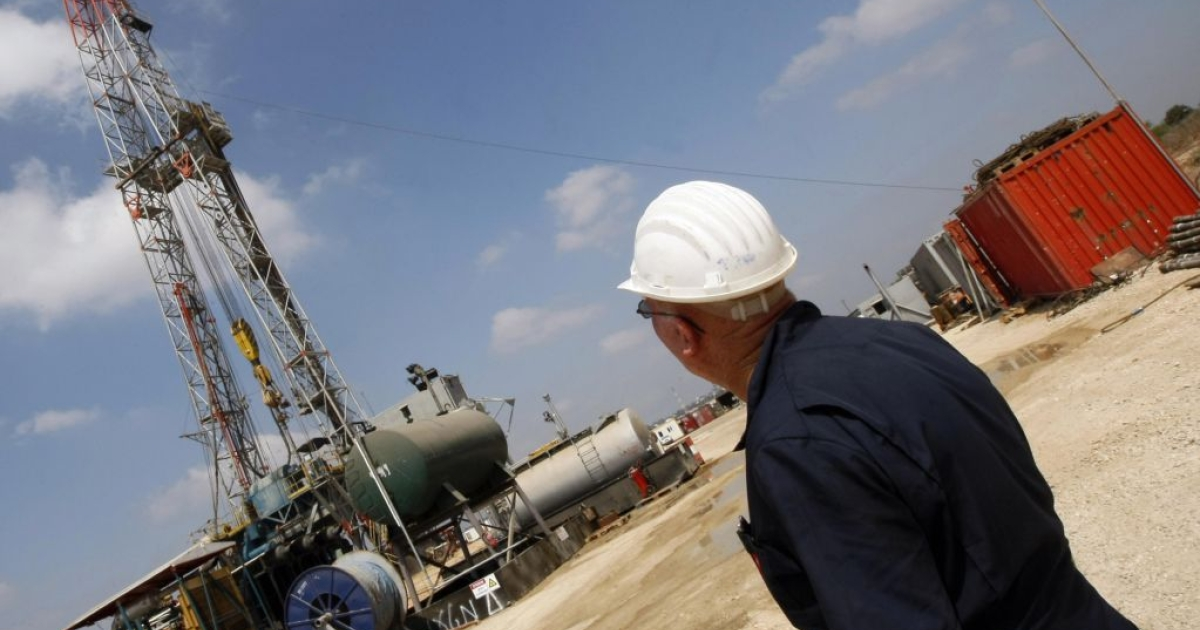 An Israeli employee works at Zion Oil and Gas company's oil-drilling platform in Israel's onshore rig in Maanit in 2009.</p>