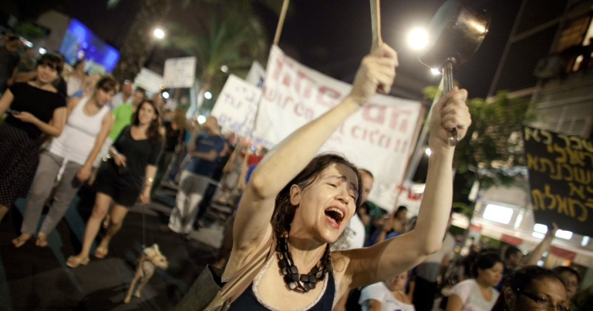 Israelis march to protest against rising housing prices and social inequalities on July 23, 2011 in Tel Aviv, Israel.</p>