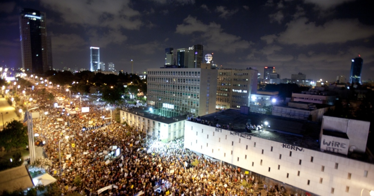 Hundreds of thousands of people march in the streets of Tel Aviv, Israel on Aug. 6, 2011,</p>