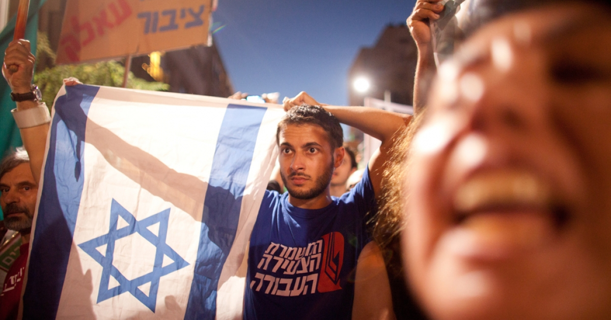 Demonstrators march through the streets to protest rising housing costs on July 14, 2012 in Tel Aviv, Israel.</p>
