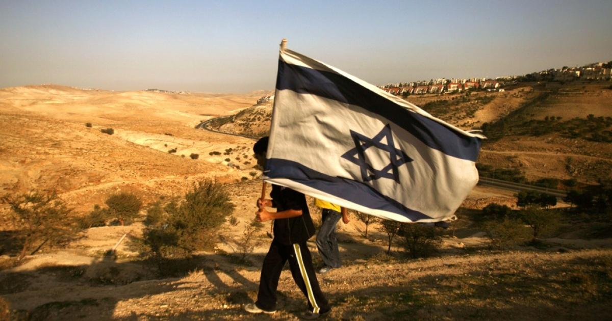 An Israeli settler walks in the E1 settlement area of the West Bank.</p>