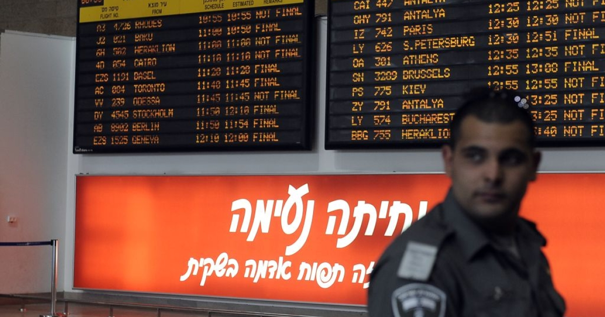An Israeli border policeman stands next to the international arrivals board at Ben Gurion airport near Tel Aviv. Hundreds of Israeli police, many undercover, are at the airport to block the arrival of activists taking part in a 'Welcome to Palestine' fly-in.</p>