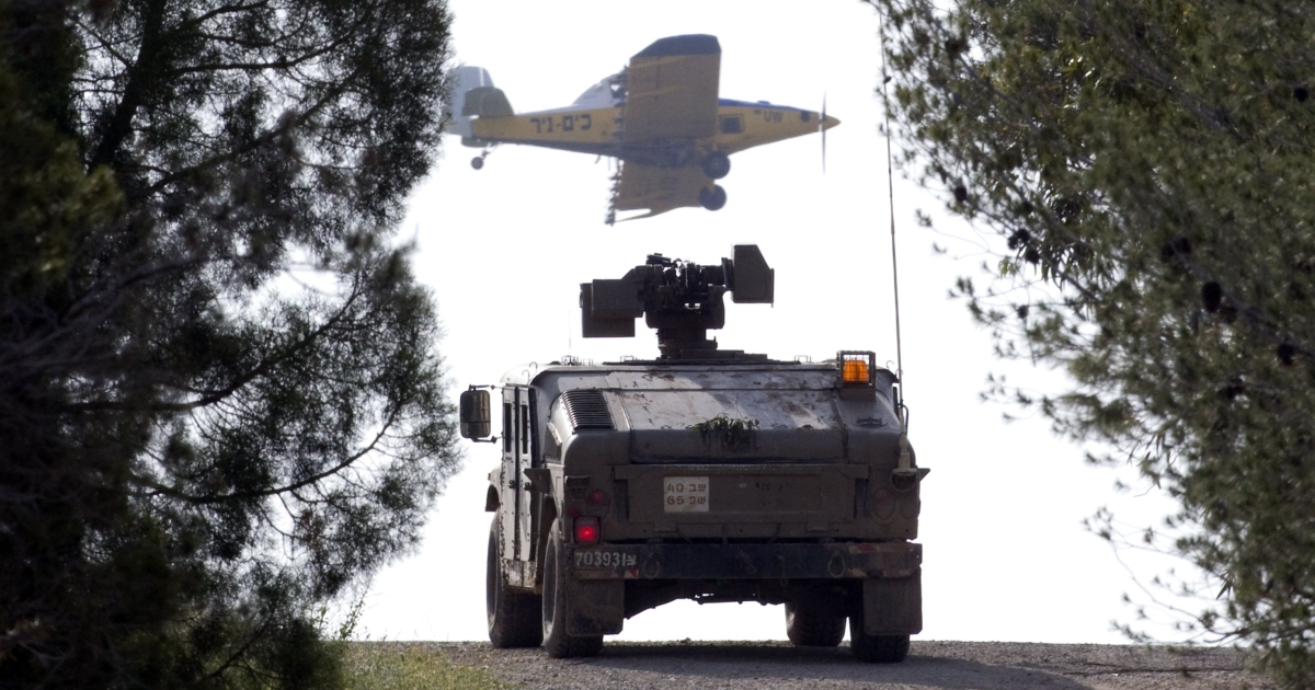 An Israeli Hummer patrols along the border with the Gaza Strip in the southern Israel town of Nahal Oz on April 8, 2011, as three Palestinian civilians were killed and four more people hurt today in an air raid on south Gaza, minutes after six rockets fired from inside the Gaza Strip had landed in Israel.</p>