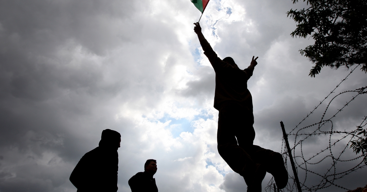 Palestinian youths take part in a weekly demonstration against Israel's separation barrier in the West Bank village of Bilin on March 25, 2011.</p>