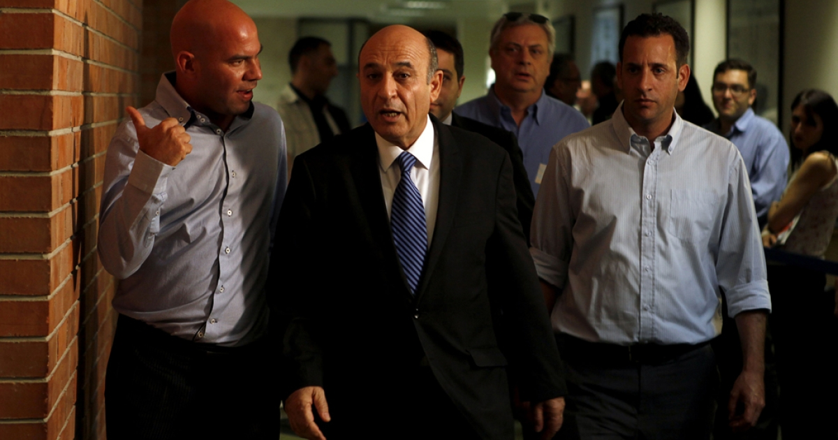 Shaul Mofaz (C), Chairman of the Kadima party, arrives for a special faction meeting at the Knesset (Israel's Parliament) on July 11, 2012 in Jerusalem. Mofaz said on July 17, 2012 that Kadima was leaving the government coalition.</p>