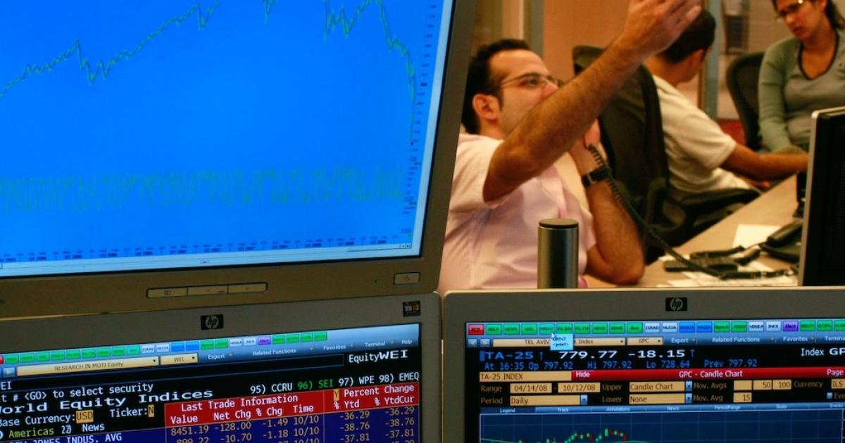 A trader on the floor of the Tel Aviv Stock Exchange on October 12, 2008 in Tel Aviv, Israel.</p>