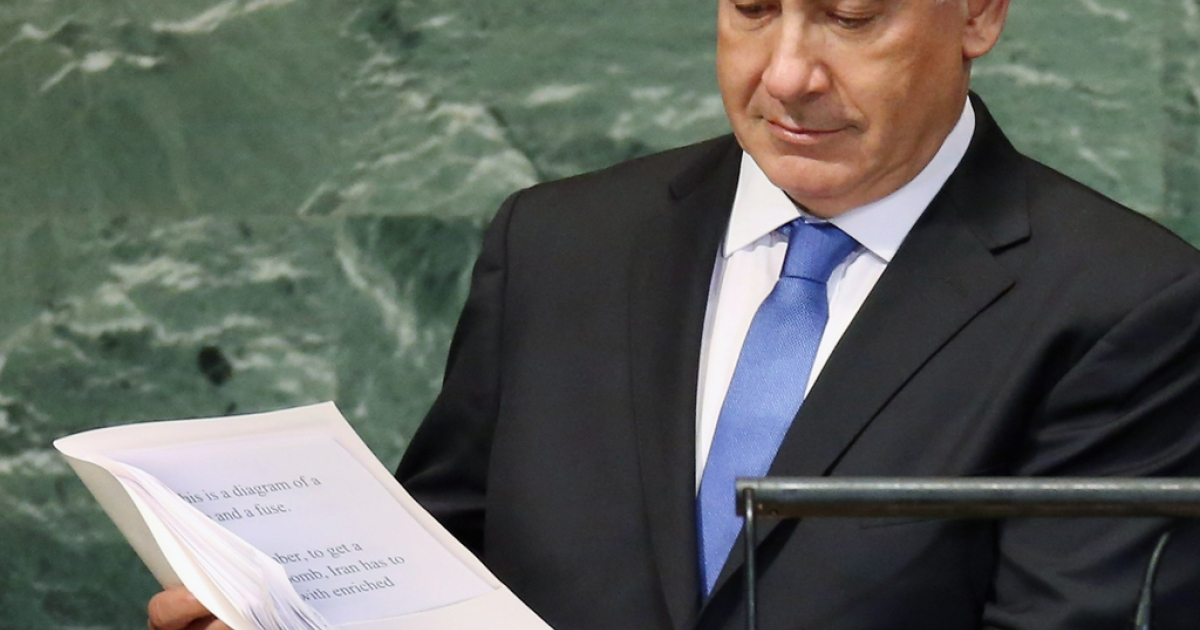 Benjamin Netanyahu, Prime Minister of Israel, prepares to address the United Nations General Assembly with part of his speech text visible on September 27, 2012 in New York City.</p>
