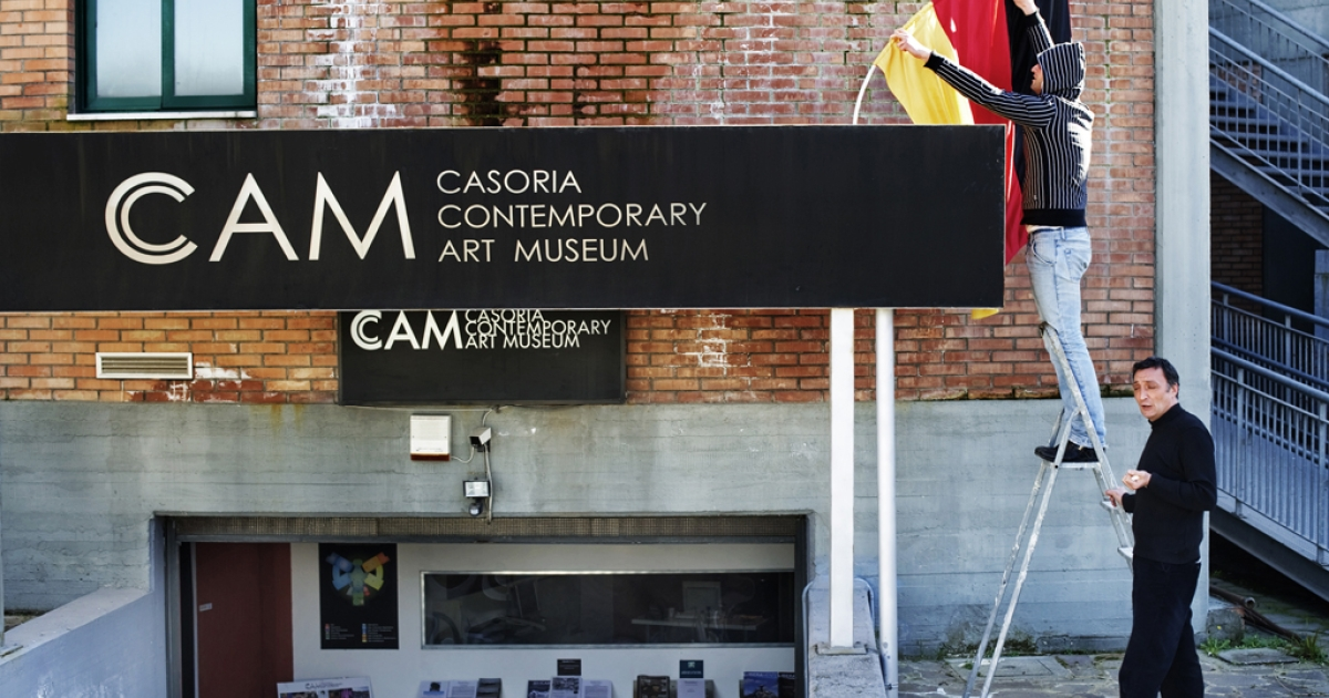 Workers of the CAM Museum (Casoria Contemporary Art Museum) place a German flag at the entrance of the museum in Casoria. Antonio Manfredi, director of the CAM in Naples, planned to burn three works of art a week in protest of budget cuts, he said on April 18, 2012.</p>