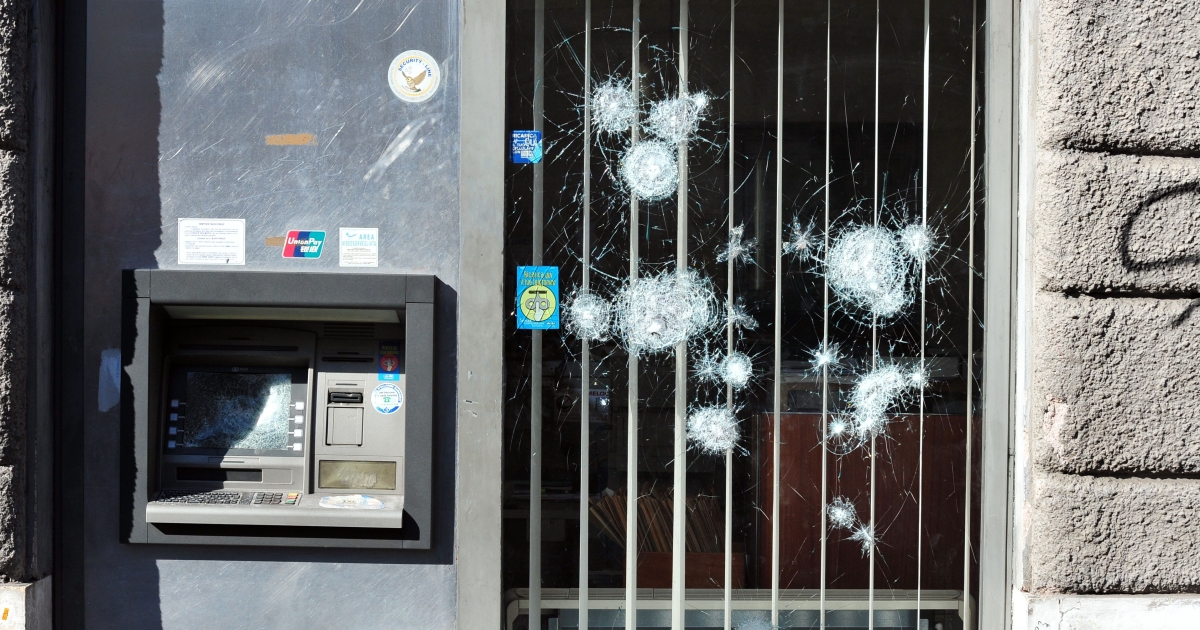 A bank with a damaged door and ATM is seen during a demonstration in downtown Rome on October 15, 2011.</p>