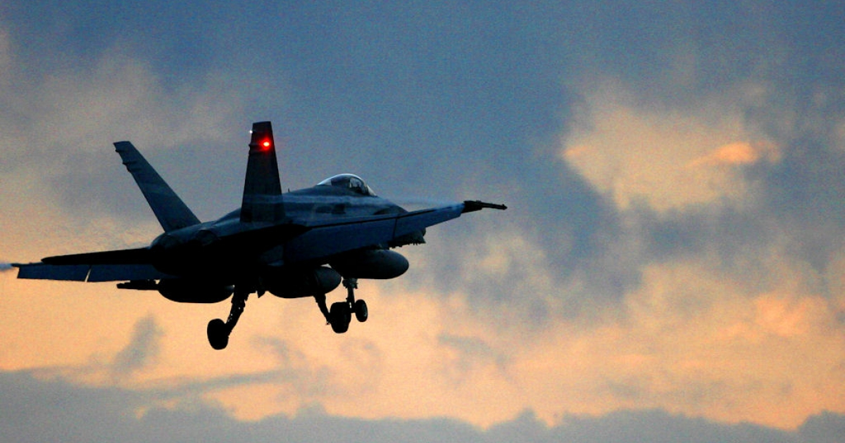 A Canadian F18 Hornet fighter flies from the air base in Trapani Birgi on the Italian island of Sicily on March 19, 2011.</p>