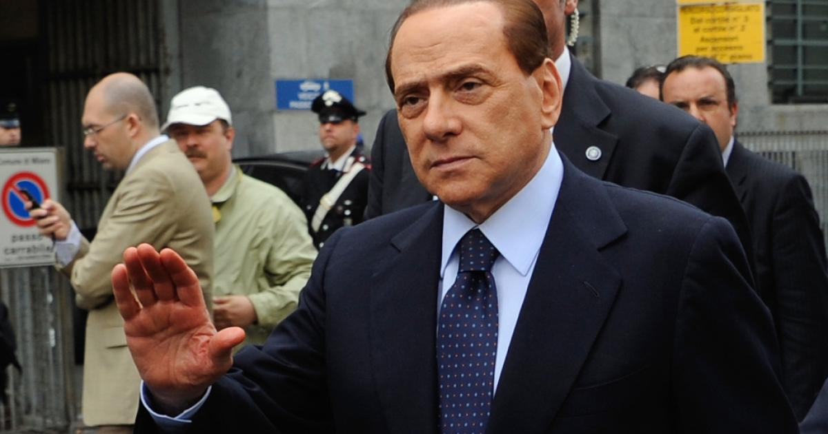 Italian Prime Minister Silvio Berlusconi arrives at Milan's justice court before a legal hearing in the Mediatrade case over allegations of fiscal fraud and breach of trust in his business interests on May 2, 2011.</p>