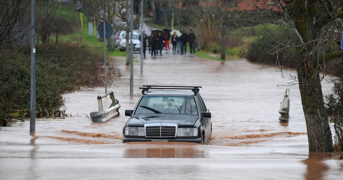 A car passes in a flooded street of Trigoria near Rome. One person died overnight near the Italian capital after strong winds and rain hit the country in December, 2008.</p>