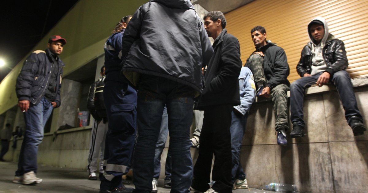 Tunisian migrants wait at Ventimiglia train station, on March 31, 2011. Italian Prime Minister Silvio Berlusconi is to visit Tunisia to discuss with the new government there how to stem the flow of migrants to the tiny island of Lampedusa, the government in Rome said.</p>