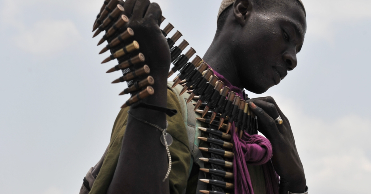 A pro-Alassane Ouattara fighter manipulates an ammunition belt during a patrol in Abidjan on April 14, 2011.</p>