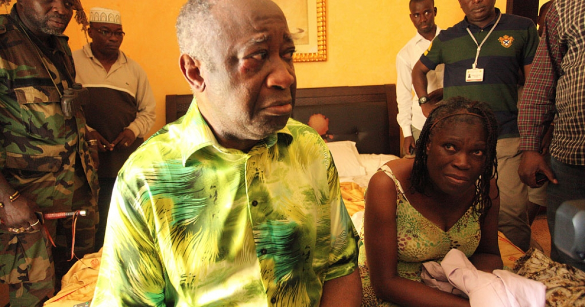 Ivory Coast strongman Laurent Gbagbo and his wife Simone sit on a bed at the Golf Hotel in Abidjan after their arrest on April 11, 2011.</p>
