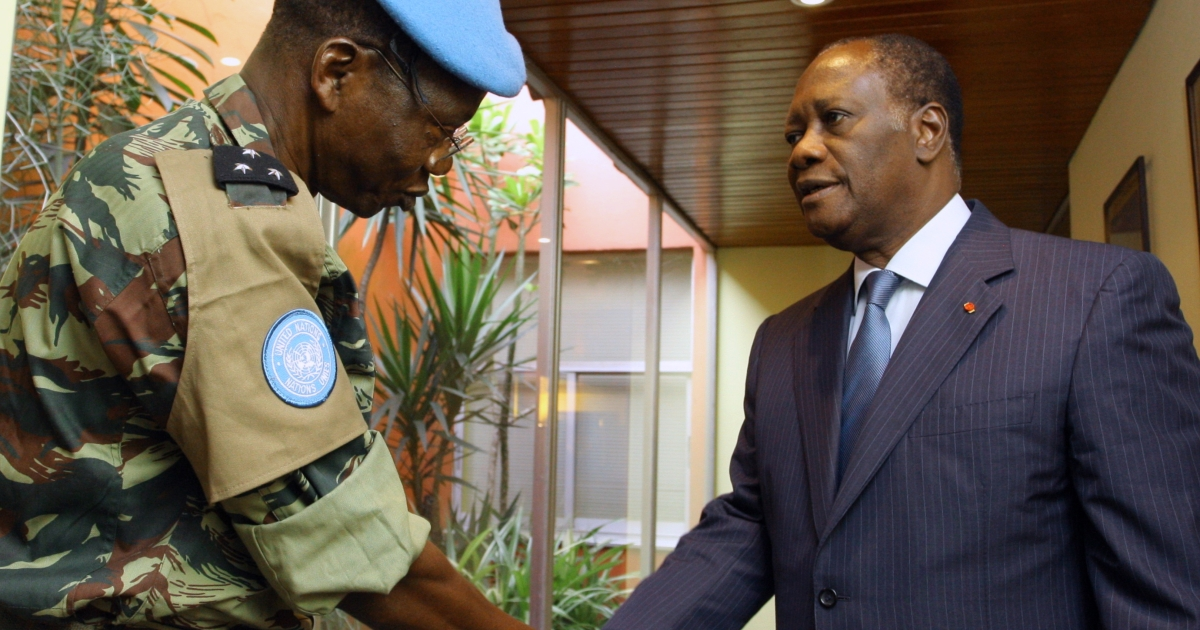 Ivory Coast's internationally recognized president Alassane Ouattara (R) shakes hands with new chief general of the United Nations peacekeeping forces Berena Gnakoude on March 22, 2011 at the golf hotel in Abidjan.</p>