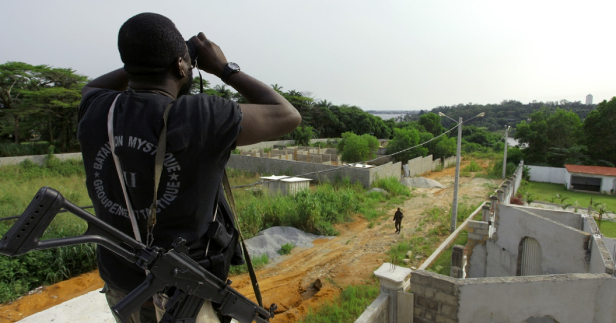 A member of Forces loyal to Ivory Coast's internationally recognised president Alassane Ouattara looks through binoculars ahead of an attack on the residence of Laurent Gbagbo in Abidjan on April 6, 2011.</p>