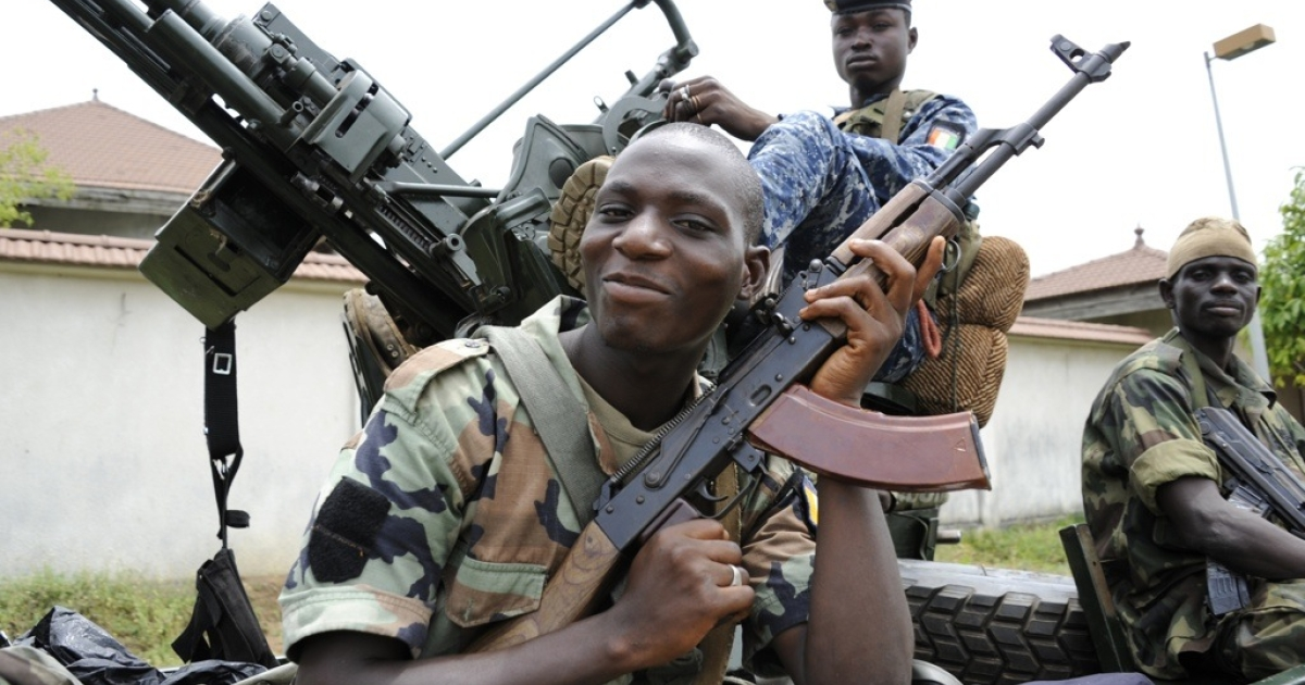 Pro-Ouattara militiamen on patrol in a district of Abidjan on April 13, 2011. Ivory Coast's President Alassane Ouattara said he would move into the palace once occupied by arrested strongman predecessor Laurent Gbagbo
