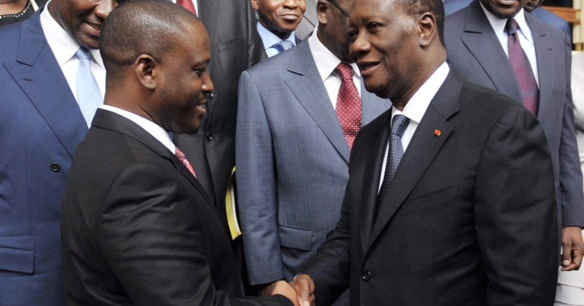 Ivory coast President Alassane Ouattara, right, and Prime Minister Guillaume Soro, left, shake hands after the first cabinet meeting since a new government was announced two days before, at Abidjan's Presidential Palace on June 3, 2011. The government faces the tough task of reconciling a country torn apart by the violence, especially in the west, where more than a million people were killed in the post-election crisis, according to the United Nations.</p>