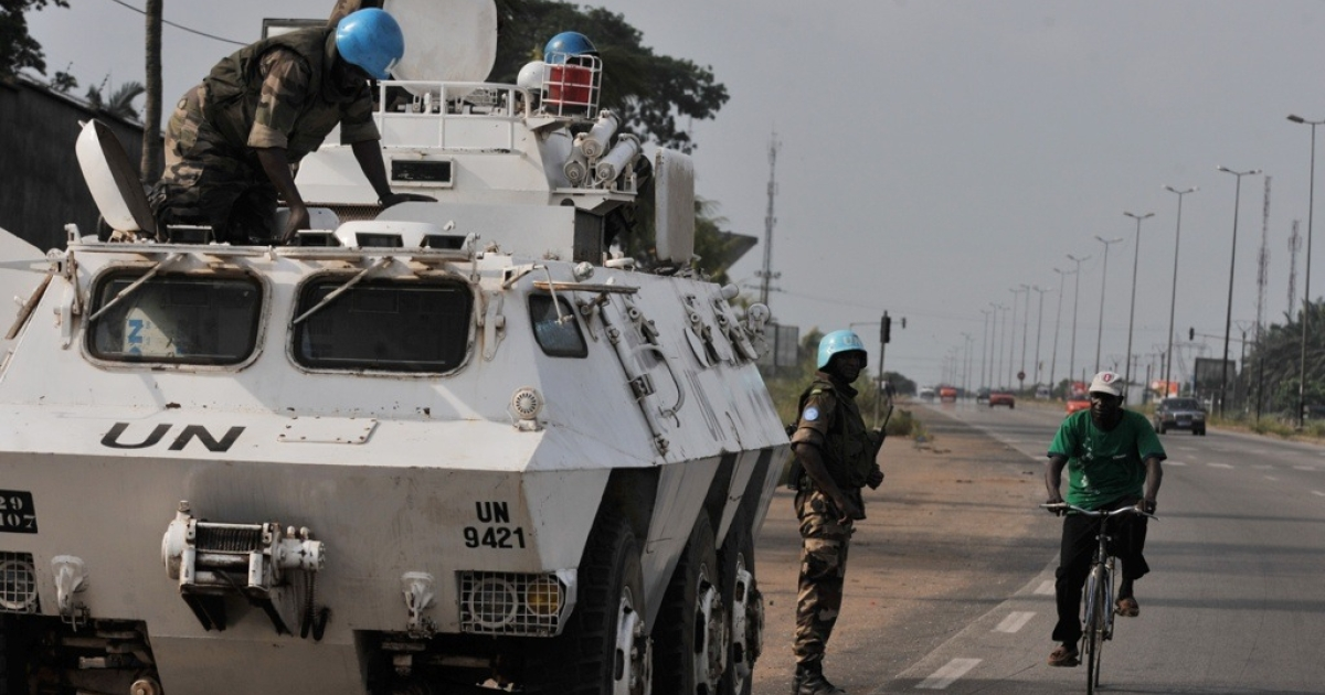 United Nations soldiers patrol on the main road to Abobo, a suburb of Abidjan on March 12, 2011. Forces loyal to Laurent Gbagbo launched an offensive against supporters of Alassane Ouattara in the Abobo district north of Abidjan.</p>