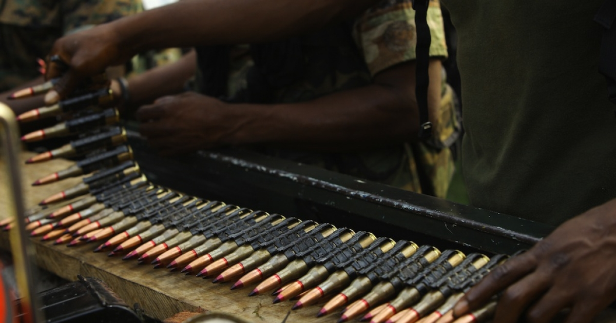 Internationally recognized leader Alassane Ouattara's soldiers prepare ammunition at the Golf Hotel in Abidjan on April 3, 2011, before an attack against strongman Laurent Gbagbo's soldiers.</p>
