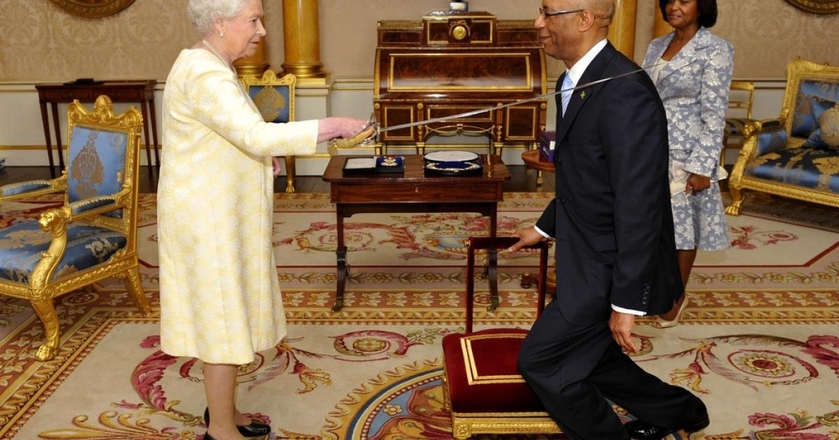 Queen Elizabeth II knights Jamaican Governor-General Sir Patrick Allen on June 12, 2009.</p>