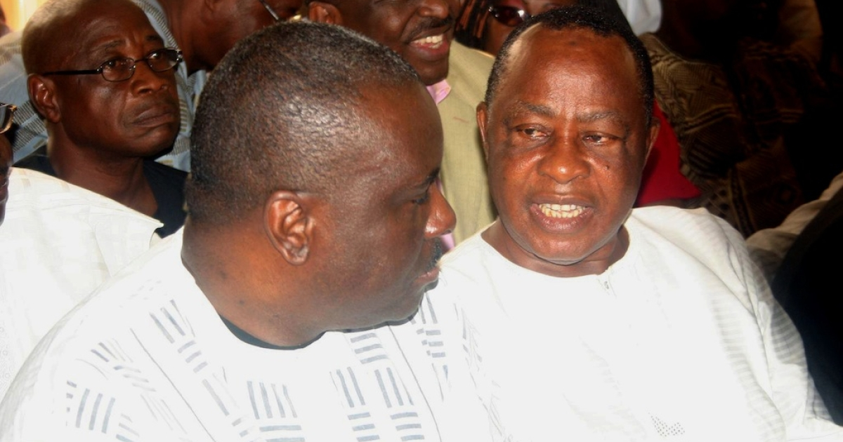 Former governor of oil-rich Delta State James Ibori (L) discusses with his former deputy Benjamin Elue in the courtroom at an Asaba High Court on December 17, 2009. The Federal High Court sitting in Asaba struck out all the charges against the governor accused of stealing millions of dollars during his tenure, however British police had also been investigating Ibori following the discovery of assets in the country suspected to have been acquired with stolen money. In his eight years as governor, Ibori's annual salary was less than 25,000 dollars (17,000 euros), yet according to media reports he was able to transfer millions of dollars to British bank accounts.</p>
