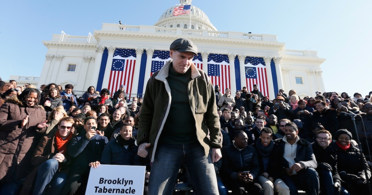 Musician James Taylor stands before the Brooklyn Tabernacle Choir at the US Capitol building during rehearsal as Washington prepares for President Barack Obama's second inauguration on Jan. 20, 2013 in Washington, DC</p>
