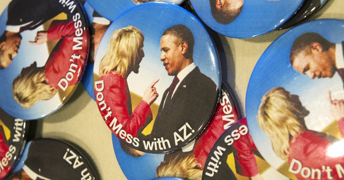 Many Arizonans take pride in their no-nonsense Republican Governor Jan Brewer. Here's a photo of Brewer wagging a finger in President Barack Obama's face, turned into buttons that say