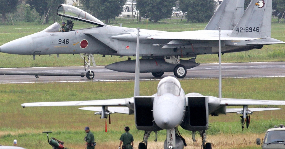 Japanese F-15 fighter jets parked at Hyakuri Air Base, Ibaraki prefecture, north of Tokyo.</p>