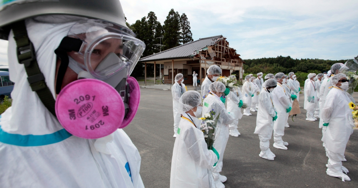 Former residents of the town of Okuma, near the stricken Tokyo Electric Power Co. (TEPCO) Fukushima Daiichi nuclear power plant, pray for victims of the March 11 earthquake and tsunami during a memorial service at Okuma in Fukushima prefecture on July 24, 2011.</p>