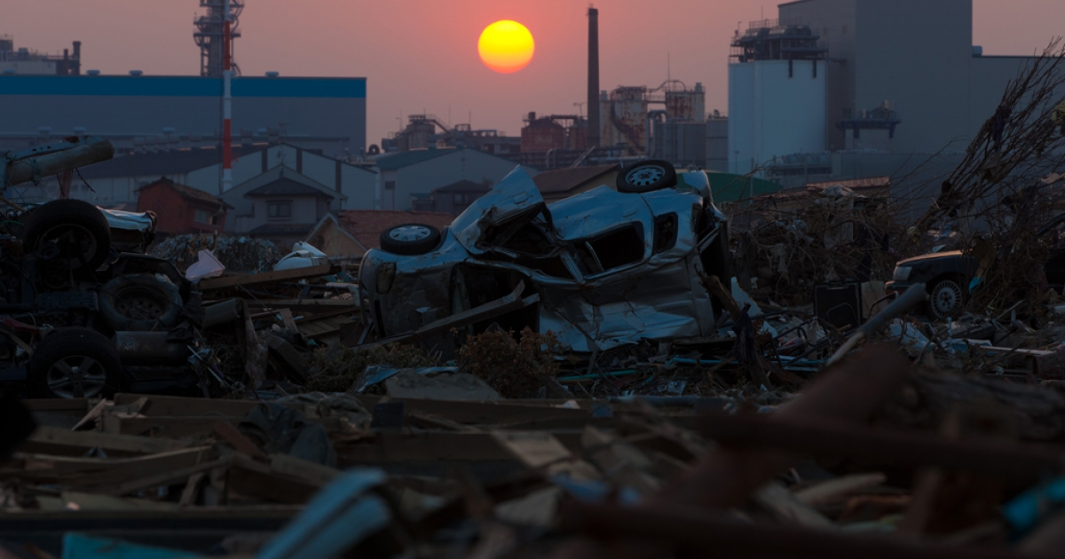 The sun sets on April 13, 2011, over debris still piled up nearly five weeks after the earthquake and tsunami disaster devastated the city of Ishinomaki in Miyagi prefecture.</p>