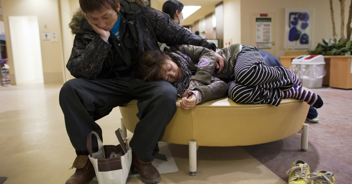 Earthquake victims wait for medical care at the Ishinomaki hospital, March 28, 2011 in Ishinomaki, Japan.</p>