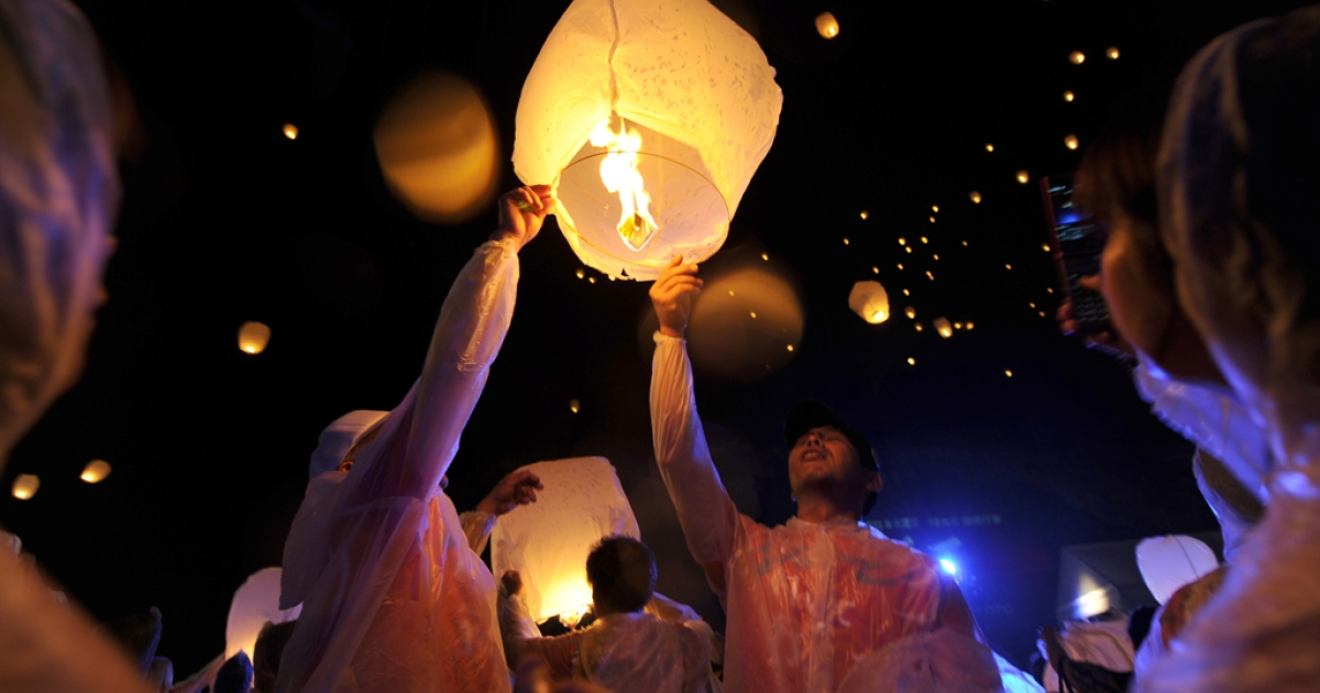 Soma city residents release lantern balloons during the