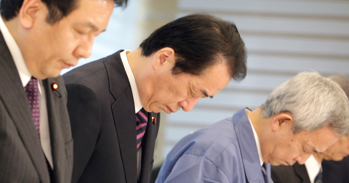 Japanese Prime Minister Noato Kan (C), Yukio Edano, Chief Cabinet Secretary (L) and Ryu Matsumoto, Environment Minister take a moment of silence prior to an emergency disaster measure meeting in Tokyo on April 11, 2011.</p>