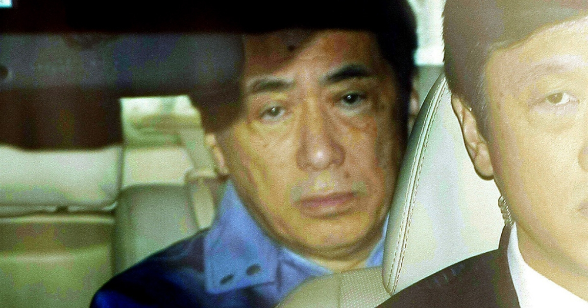 Japanese Prime Minister Naoto Kan leaves the headquarters of the Tokyo Electric Power Co after he met with TEPCO staff in Tokyo on March 15, 2011 following a third blast at the quake-hit nuclear power plant.</p>