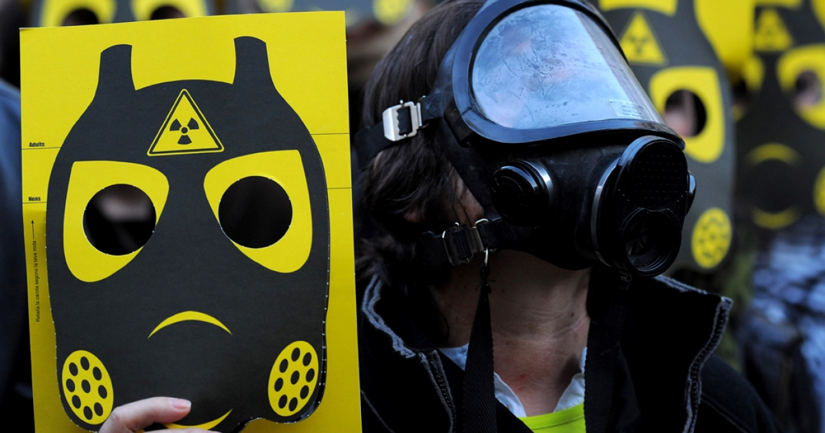 Anti-nuclear activists participate in a demonstration on March 17, 2011 in Sant Jaume square, in Barcelona. Thousands of anti-nuclear demonstrators, in reaction to the dramatic situation at the Fukushima nuclear facility in Japan, gathered in cities across Spain to protest the government-granted extension of the operational lives of Spain's older nuclear power plants.</p>