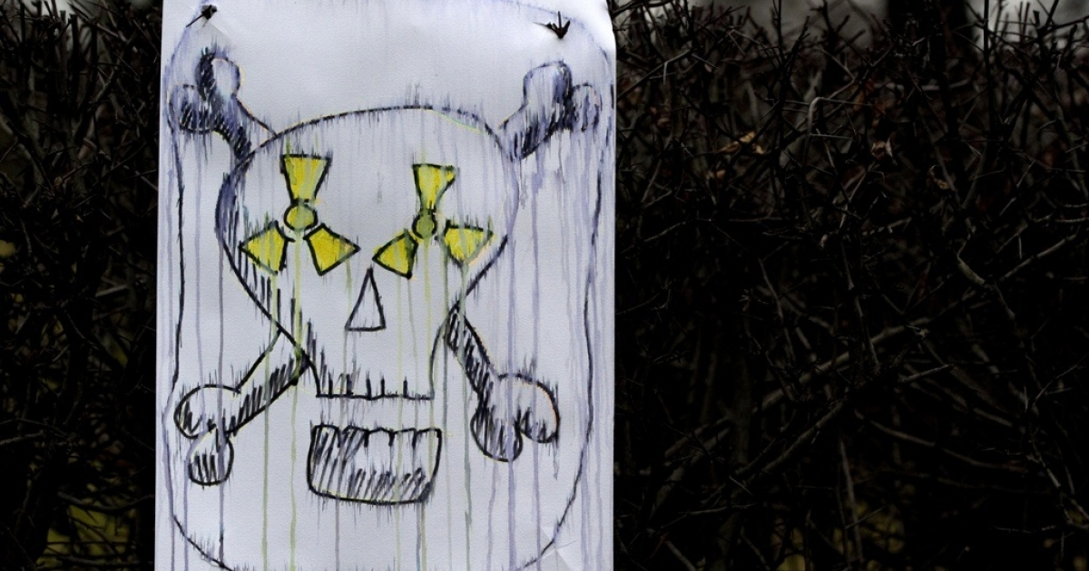 A placard showing a skull has been left by anti-nuclear protesters near the Reichstag building on March 14, 2011 in Berlin.</p>
