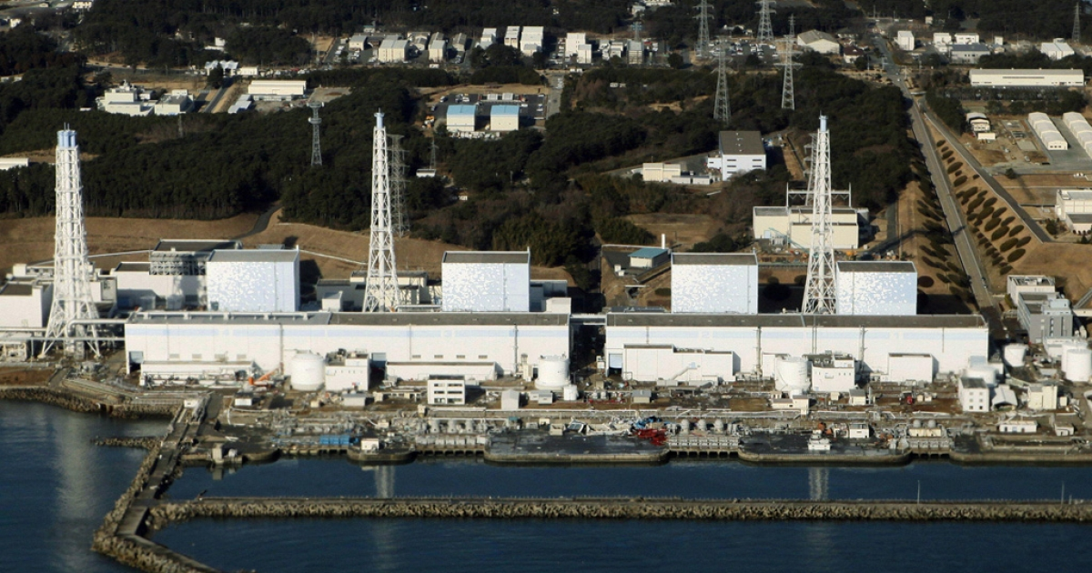 An aerial view shows the quake-damaged Fukushima nuclear power plant on March 12, 2011.</p>