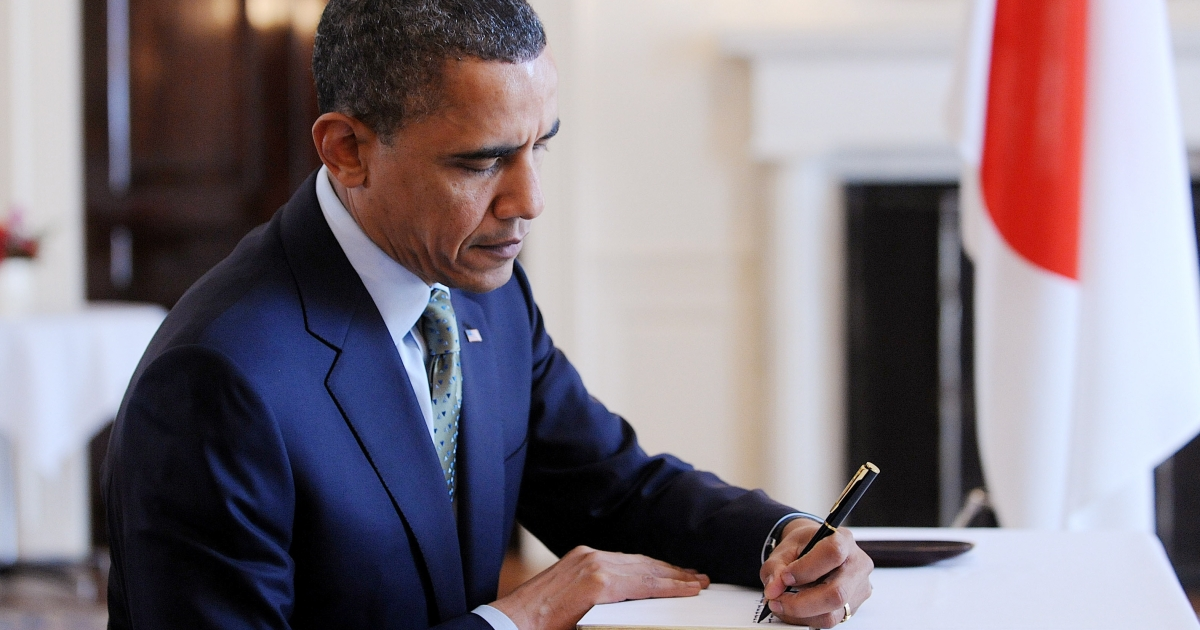 U.S. President Barack Obama makes an entry in a book of condolences during a surprise visit to the Japanese embassy March 17, 2011, in Washington D.C. Japan is struggling to contain a potential nuclear meltdown resulting from the powerful earthquake and tsunami last Friday and subsequent aftershocks.</p>