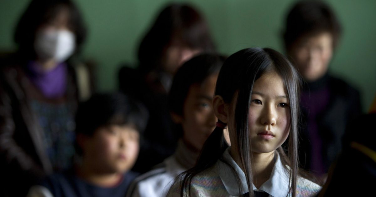 Saya Takahashi,12, sits in class during an emotional graduation ceremony for the 6th grade at the Ohya Elementary school March 23, 2011 in Kesennuma, Japan.</p>